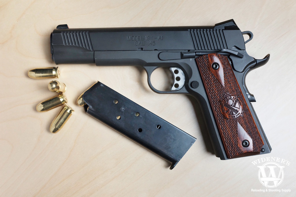 a photo of a Springfield 45 pistol with best 45 acp ammo