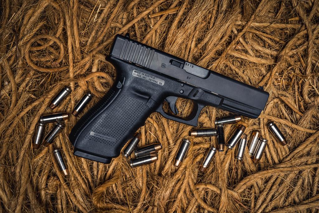 photo of glock 20 10mm pistol on ropes