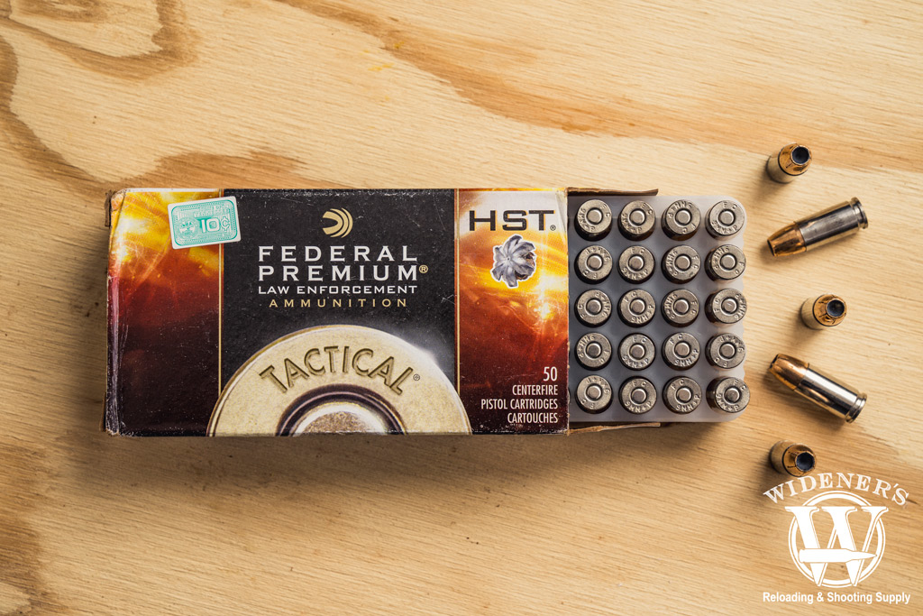 photo of federal HST premium law enforcement 9mm JHP ammunition on plywood