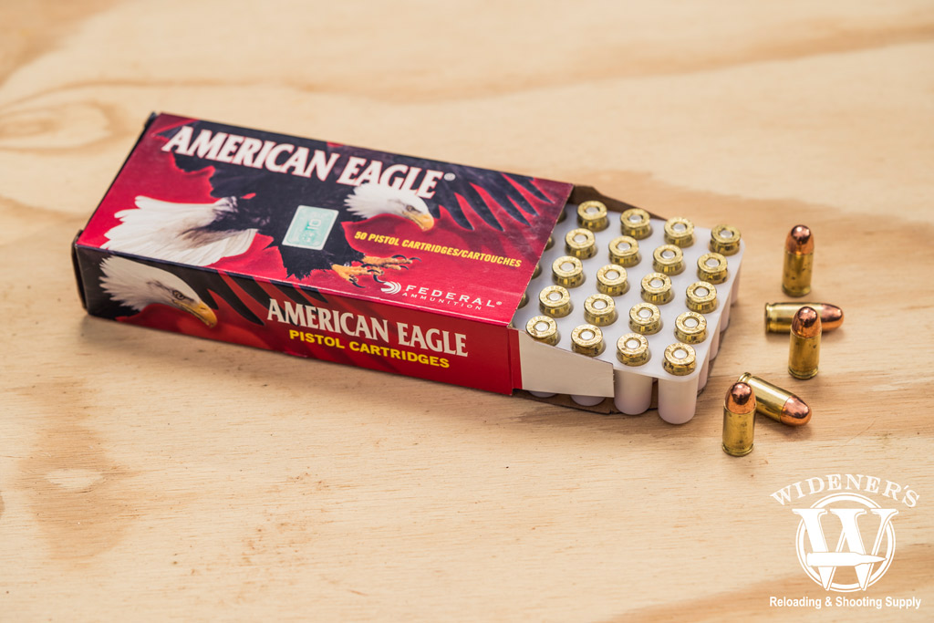 photo of federal american eagle best 380 ammo on a sheet of plywood