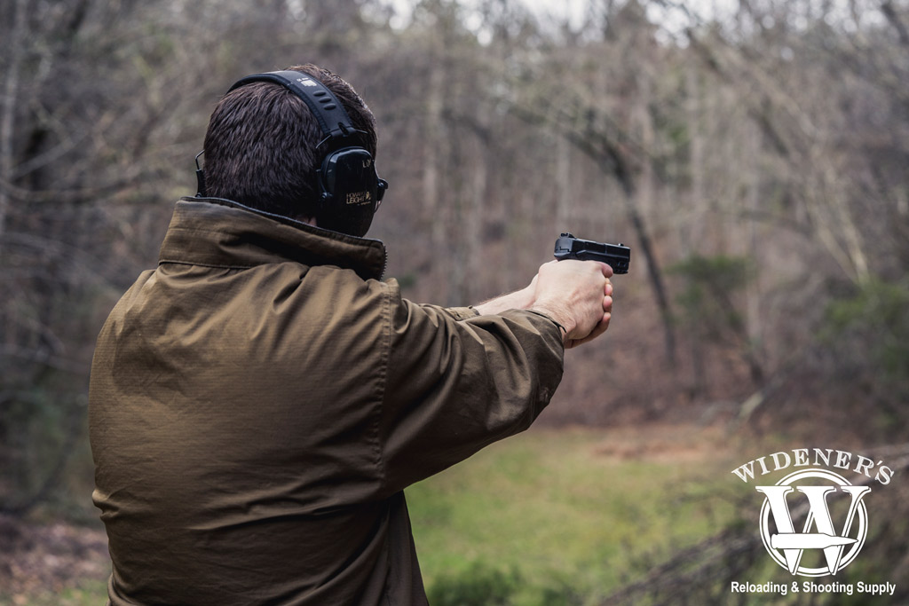 photo of a man shooting a smith & wesson M&P 380 acp handgun