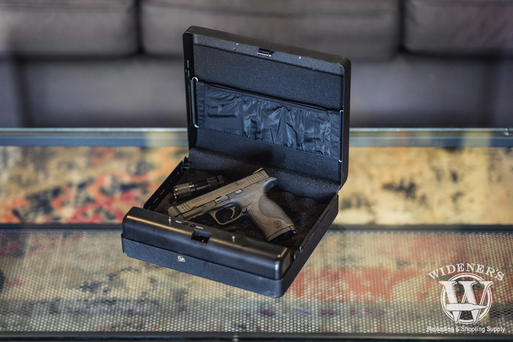 a photo of a smith and wesson pistol sitting in a safe used as the best home defense
