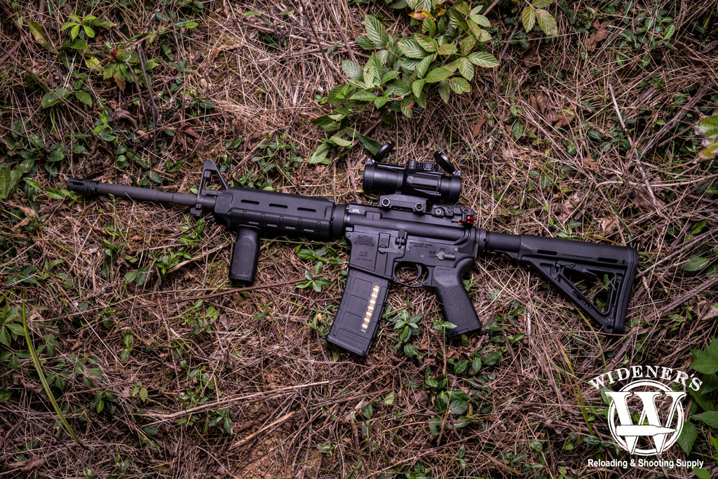 photo of an ar15 rifle with magpul furniture outdoors