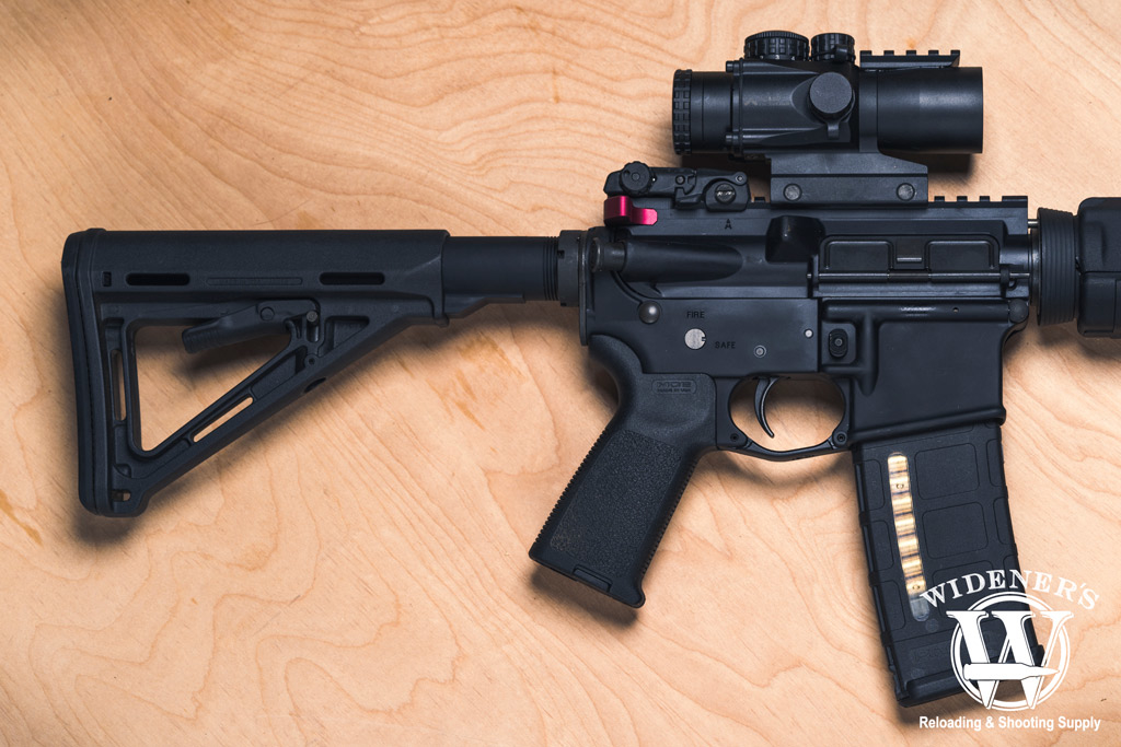 photo of an ar15 rifle on plywood