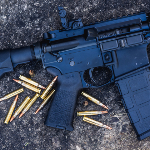 photo of an ar-15 rifle outdoors with 223 ammunition