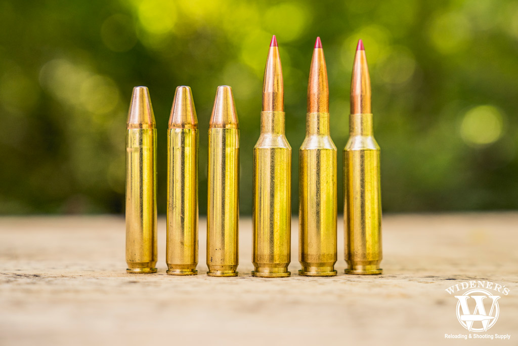 A photo of 350 legend ammo compared to 6.5 creedmoor ammo outdoors
