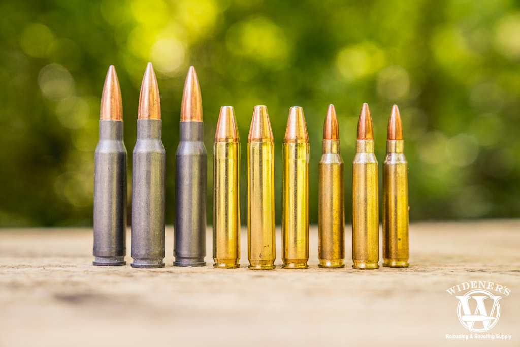 a photo of 7.62x30 ammo compared to 350 legend ammo compared to 5.56 ammo outdoors