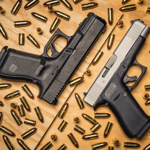 a photo of a glock 48 vs 19 with 9mm bullets