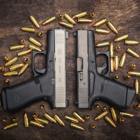 A photo of a glock 43 vs 43x with 9mm ammo