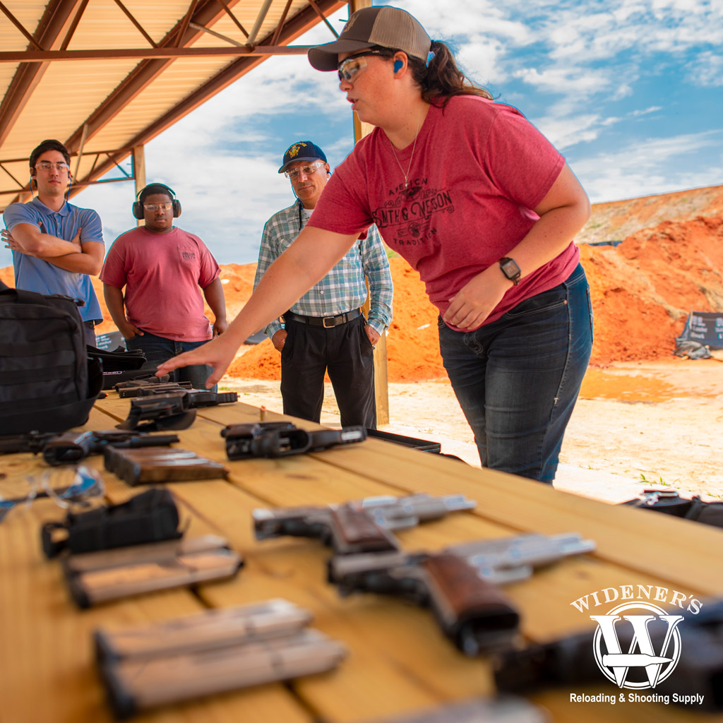 a photo of a female instructor discussing handgun safety at a conceal and carry class