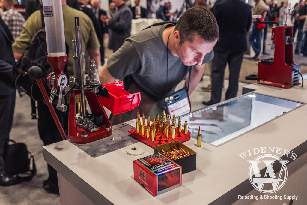 photo of a SHOT Show attendee looking at the Hornady reloading supplies