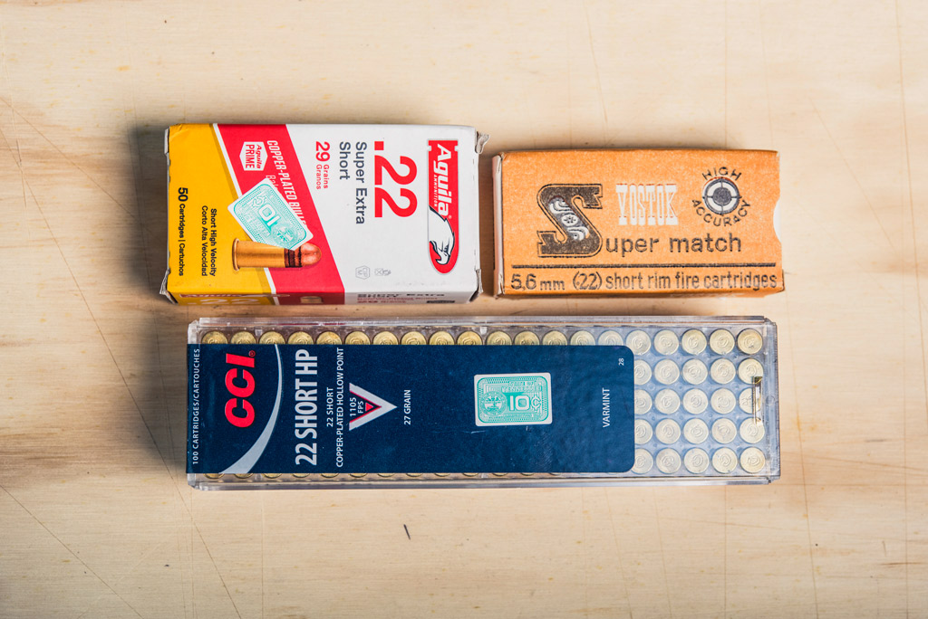 photo of boxes of 22 short ammo on plywood