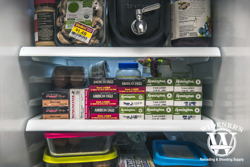 photo of ammunition stacked on the shelf of a refrigerator