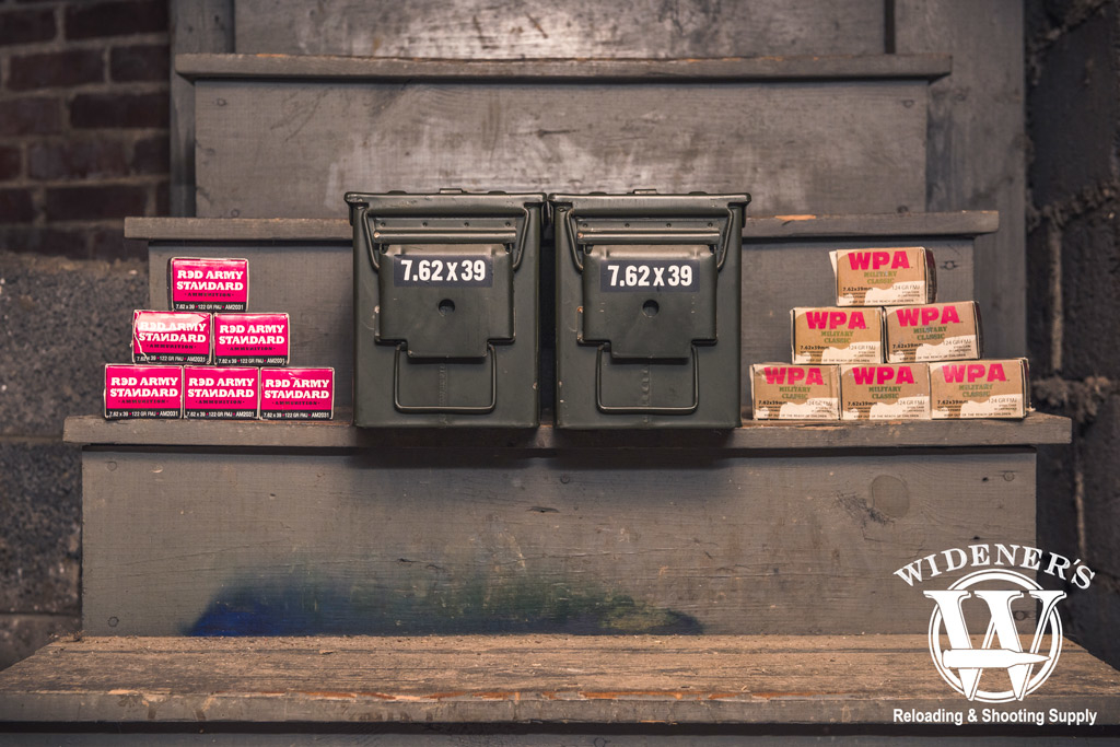 photo of ammo boxes and 50 cal ammo storage boxes stored in a basement