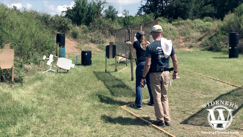 photo of competition shooting female at the gun range