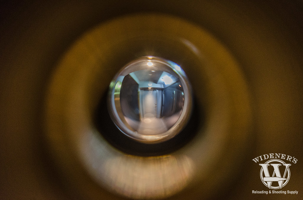 photo pov looking through a peephole at an apartment complex